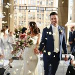 Bride and Groom exit with flower petals