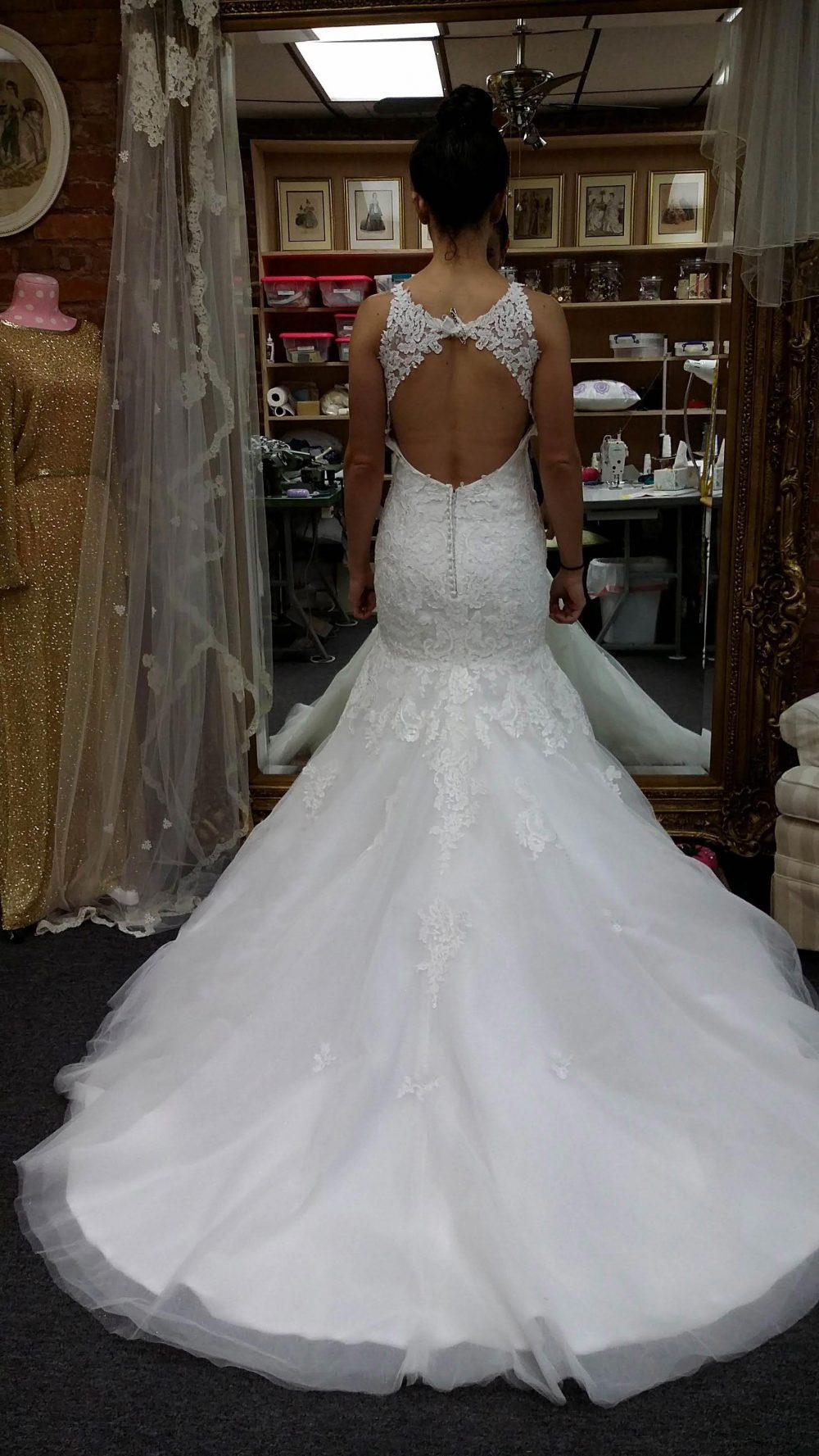 Adjusting the backside on a wedding gown